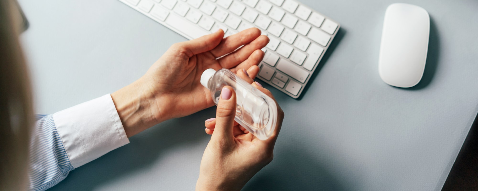Person using hand sanitizer