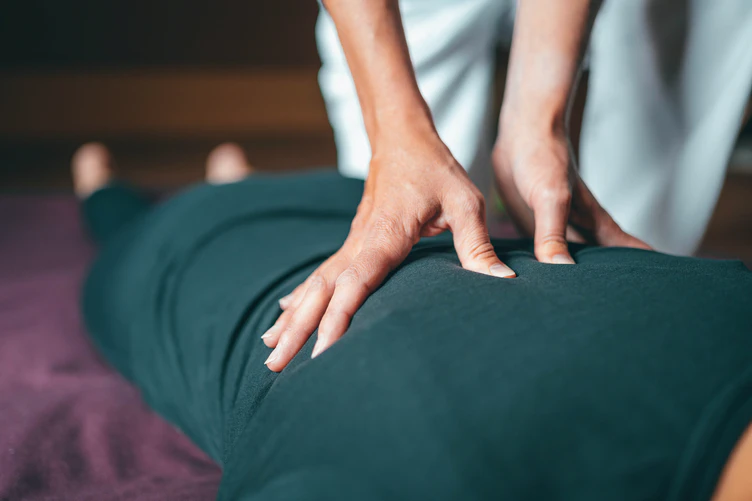 Person receiving a back massage