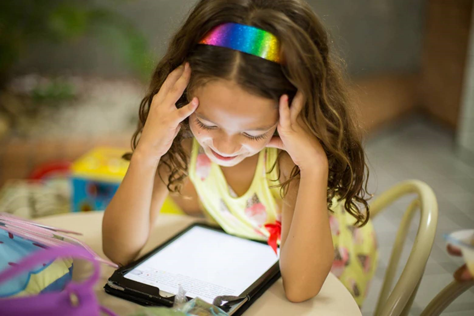 Child reading an iPad